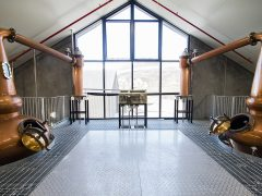 Cardrona Distillery and Museum interior steel platform with copper stills and large window