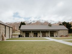 Cardrona Distillery and Museum exterior reception building with mountains in distance