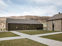 Cardrona Distillery and Museum exterior of barrell store building with lawn and pathways