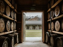 Cardrona Distillery and Museum barrel store with view outside to building and mountains