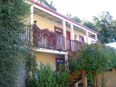 Cardrona Hotel exterior accommodation units two storeys with verandah