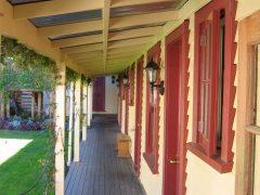 Cardrona Hotel exterior accommodation units looking down verandah