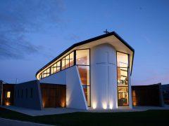 Holy Family Catholic Church Wanaka exterior at night with lights on inside