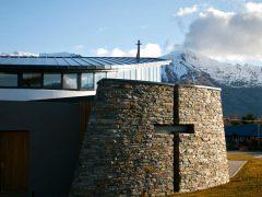 Holy Family Catholic Church Wanaka exterior schist wall with inlaid cross