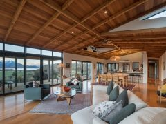 Buchanan Rise House interior living room with wood ceilings and large windows