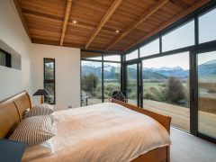 Buchanan Rise House bedroom with large windows looking at mountain view