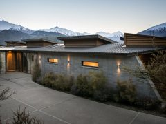 Buchanan Rise House concrete block house with mountains in background