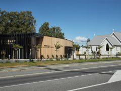 Wanaka Community Hub exterior with St Columba Church in background