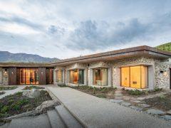 Saddle house exterior schist stone cladding building