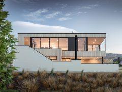 Kotare Drive house exterior cedar and white brick cladding