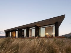 Ruby Ridge House exterior with angled roof and tussock garden