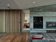 Ruby Ridge house interior living room with vertical cedar and concrete feature walls