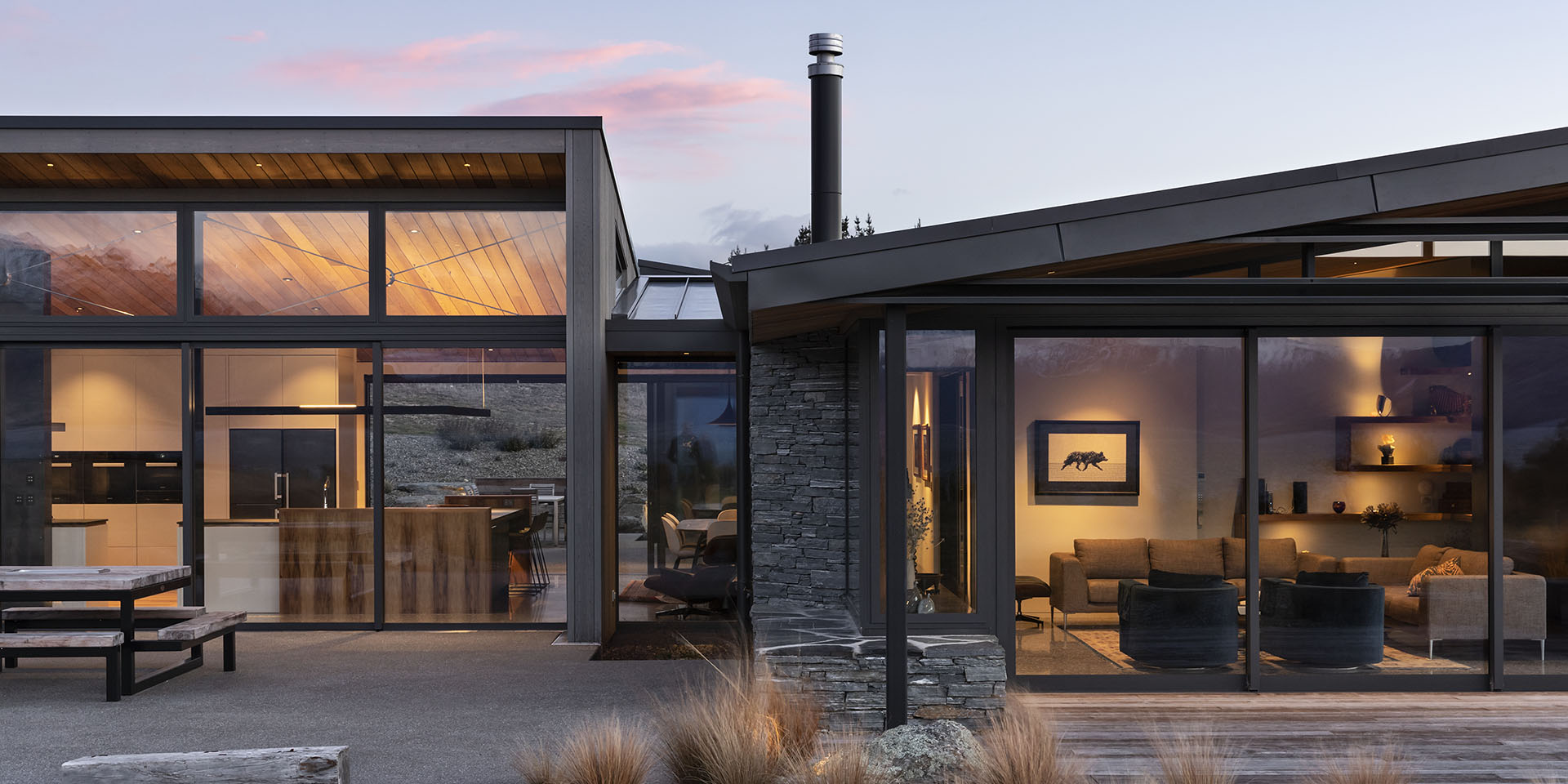 Lake Hawea House exterior front on view at dusk with lights on