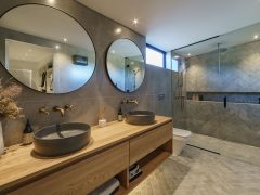 Bargour Residence interior tiled bathroom with double vanity