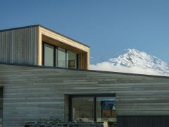 Bargour Residence exterior view close up of cladding and windows with mountains in background