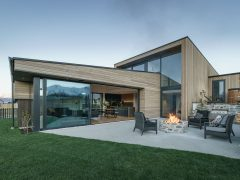 Bargour Residence exterior house with cedar cladding and courtyard and lawn