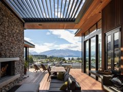 Pearl Lane House covered outdoor entertaining deck with view towards Lake Wanaka and mountains